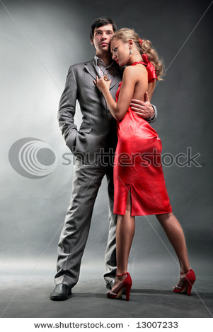 stock-photo-portrait-of-a-young-handsome-couple-young-woman-embraces-man-woman-in-a-red-dress-13007233